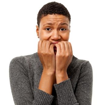Nervous Woman Bites Fingernails
